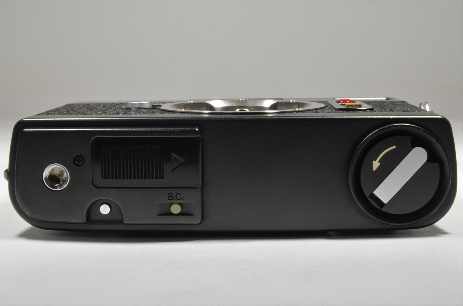 minolta cle, m-rokkor 28mm f2.8, 40mm f2, 90mm f4, flash auto cle