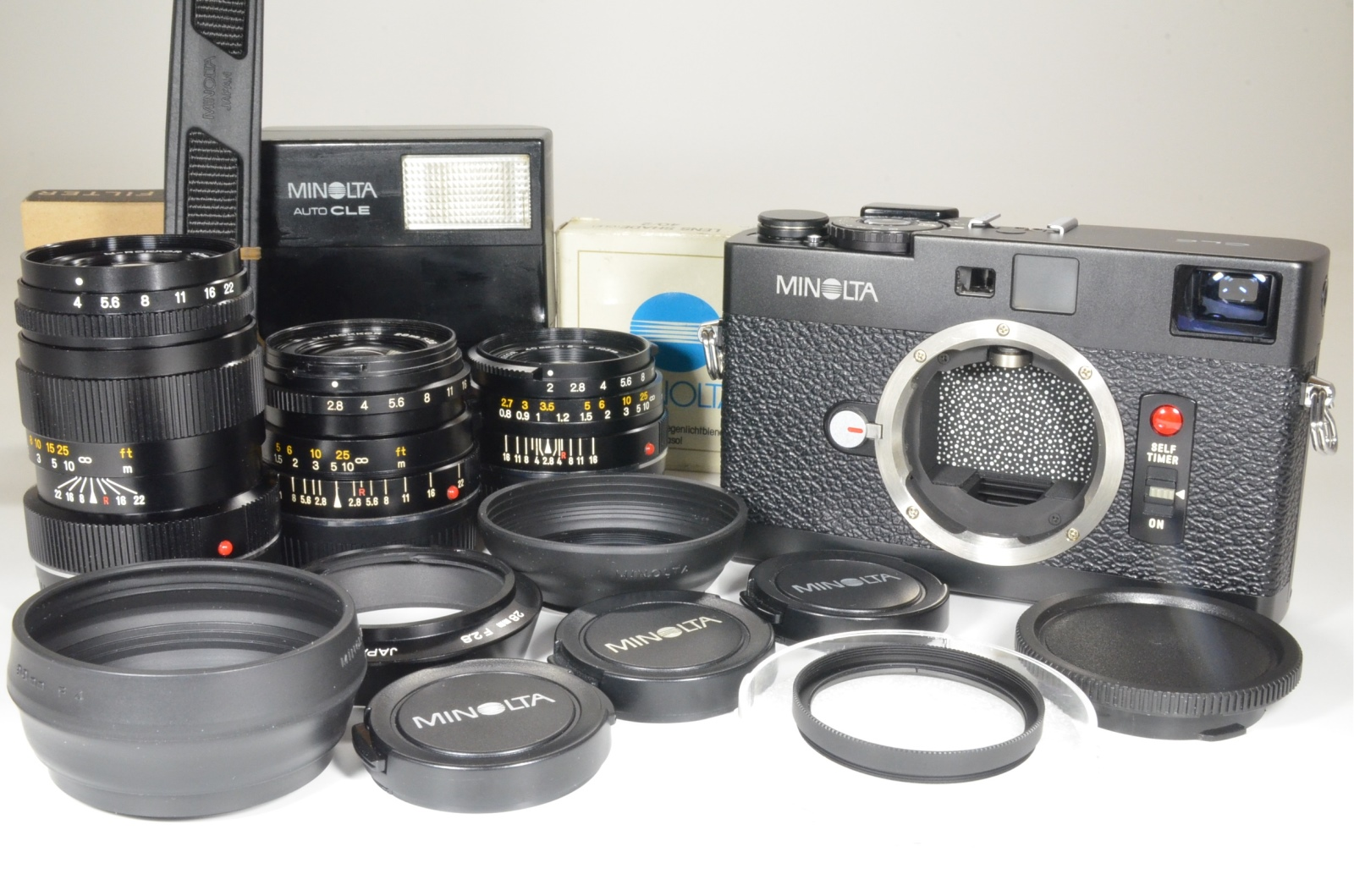 minolta cle 35mm film camera with m-rokkor 40mm f2, 28mm f2.8, 90mm f4 and flash