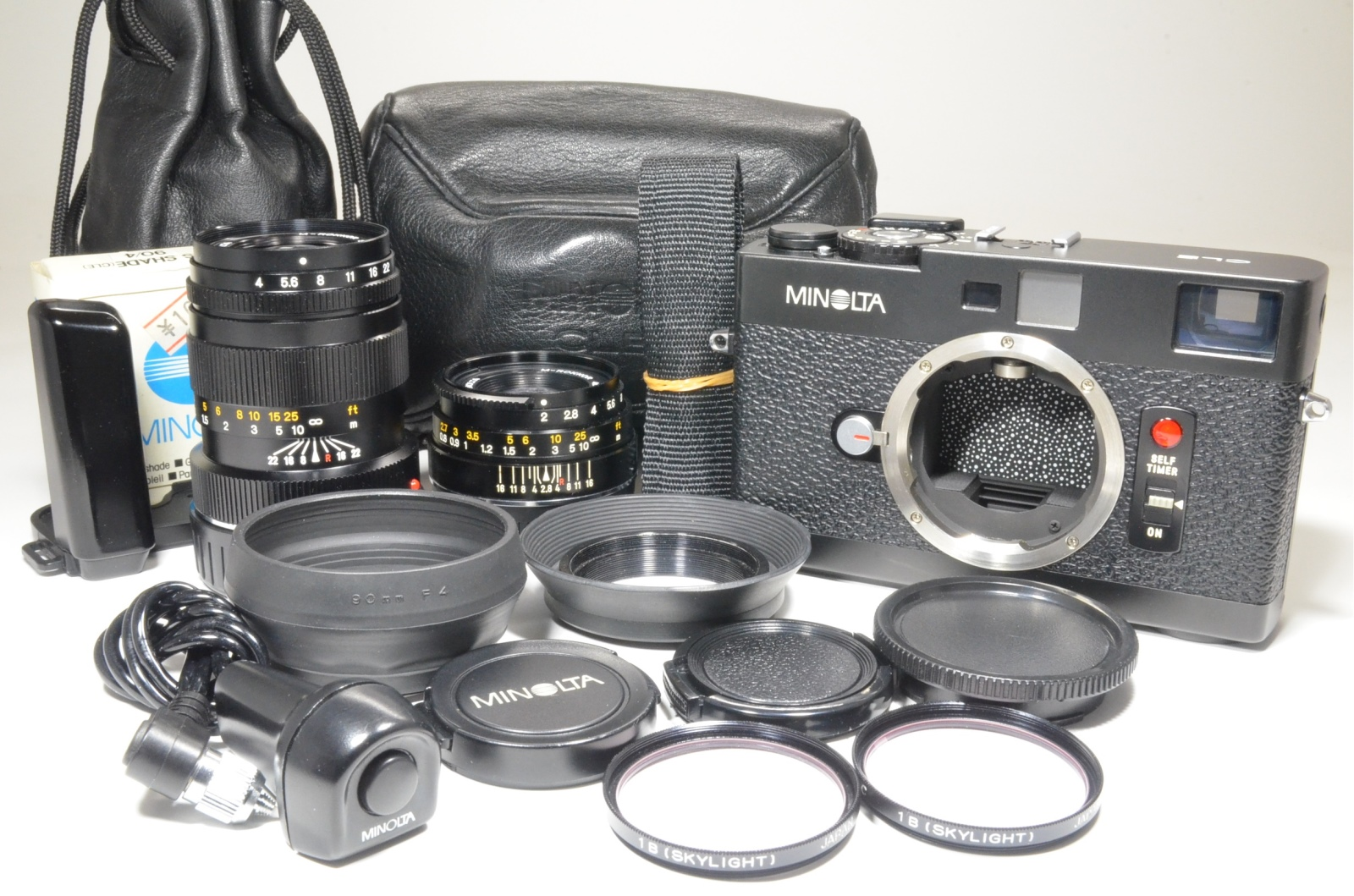 minolta cle 35mm film camera, m-rokkor 40mm f2, 90mm f4, grip and cable release