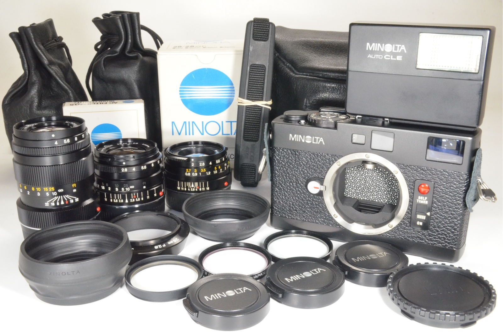 minolta cle film camera w/ m-rokkor 40mm, 28mm, 90mm and flash, film tested