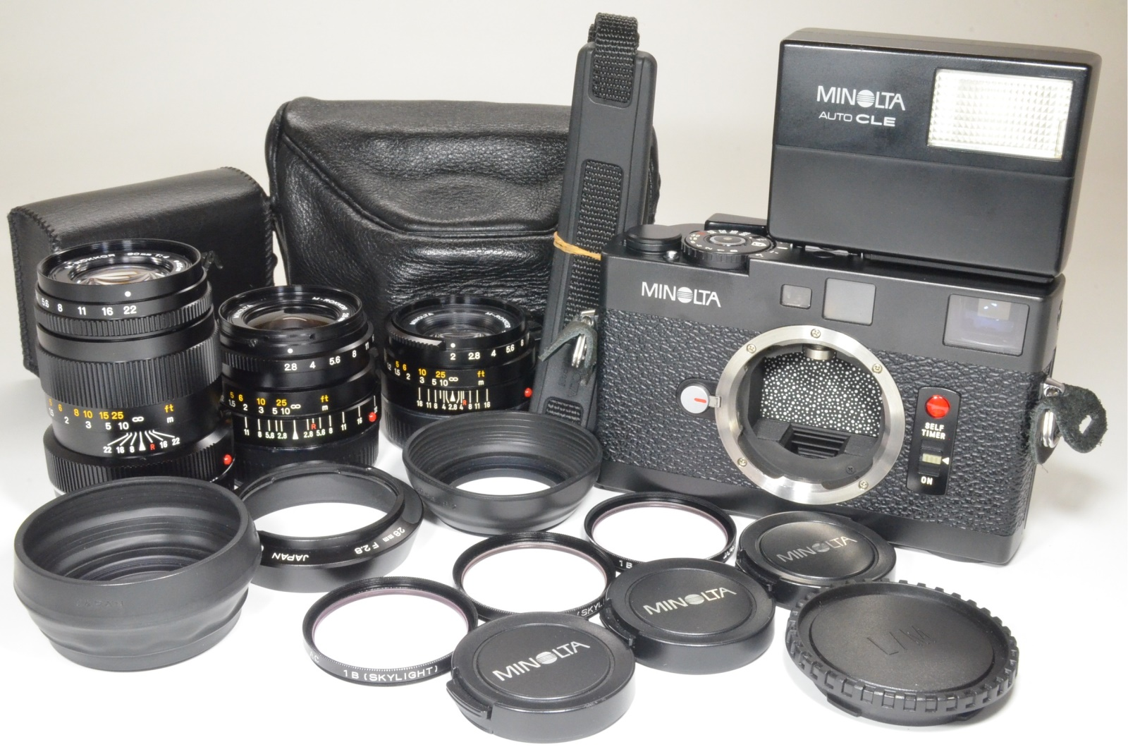 minolta cle 35mm film camera with m-rokkor 40mm f2, 28mm f2.8, 90mm f4 and case