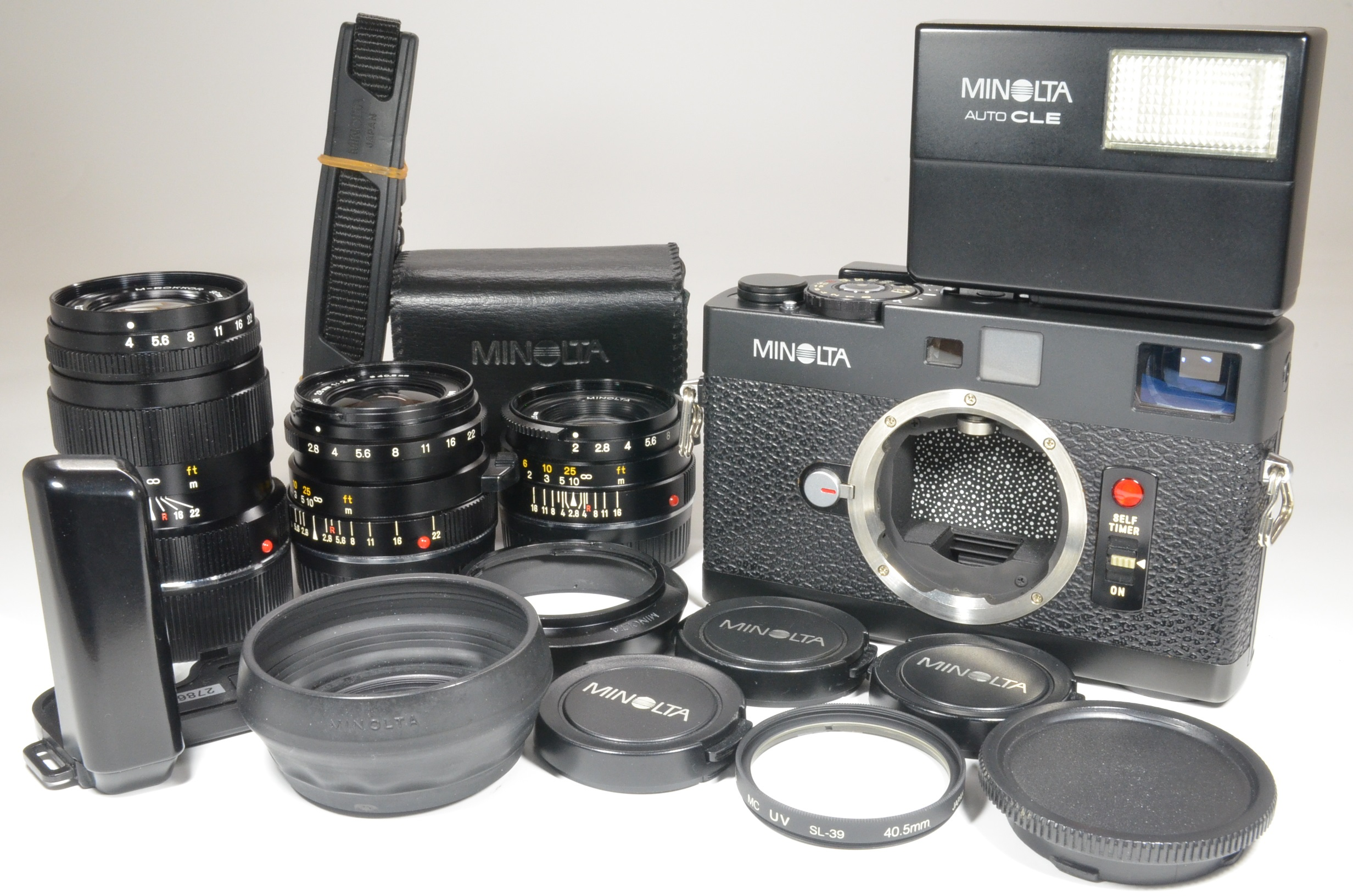 minolta cle film camera with m-rokkor 40mm, 28mm, 90mm, flash, strap and grip