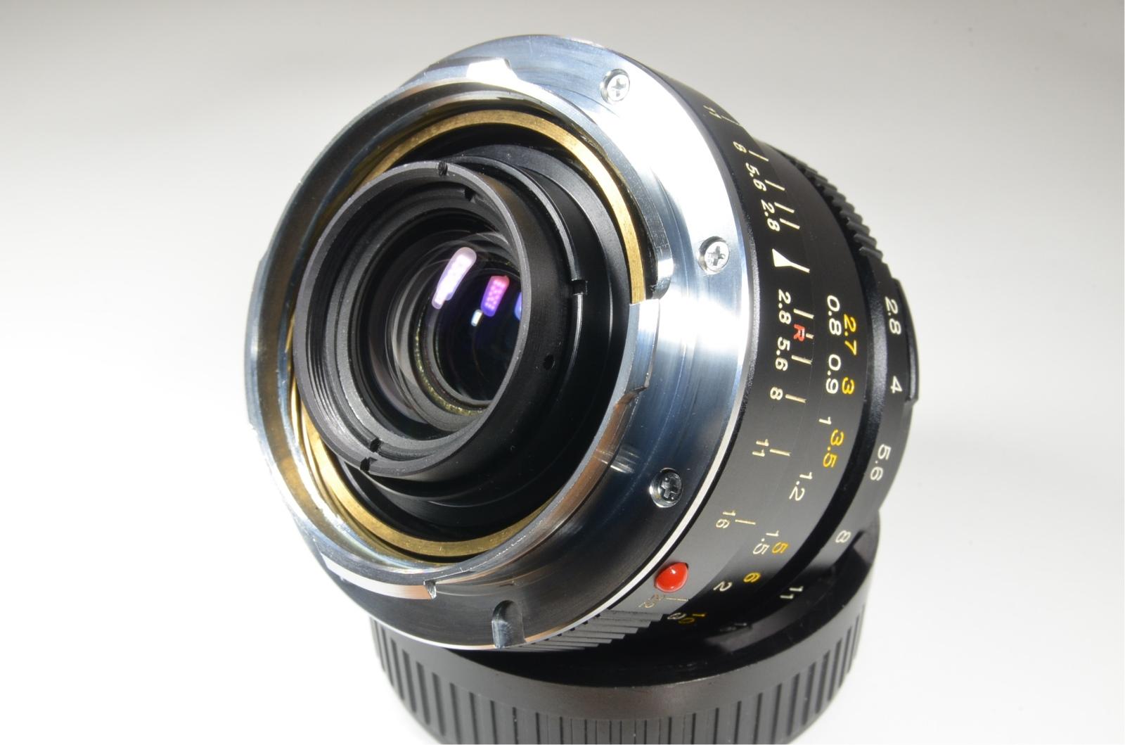 minolta cle film camera, m-rokkor 40mm, 28mm, 90mm, flash and grip