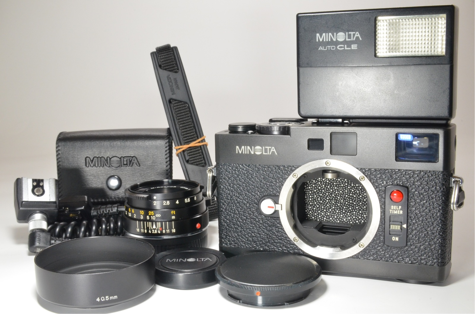 minolta cle with m-rokkor 40mm f2, strap, flash, cable oc