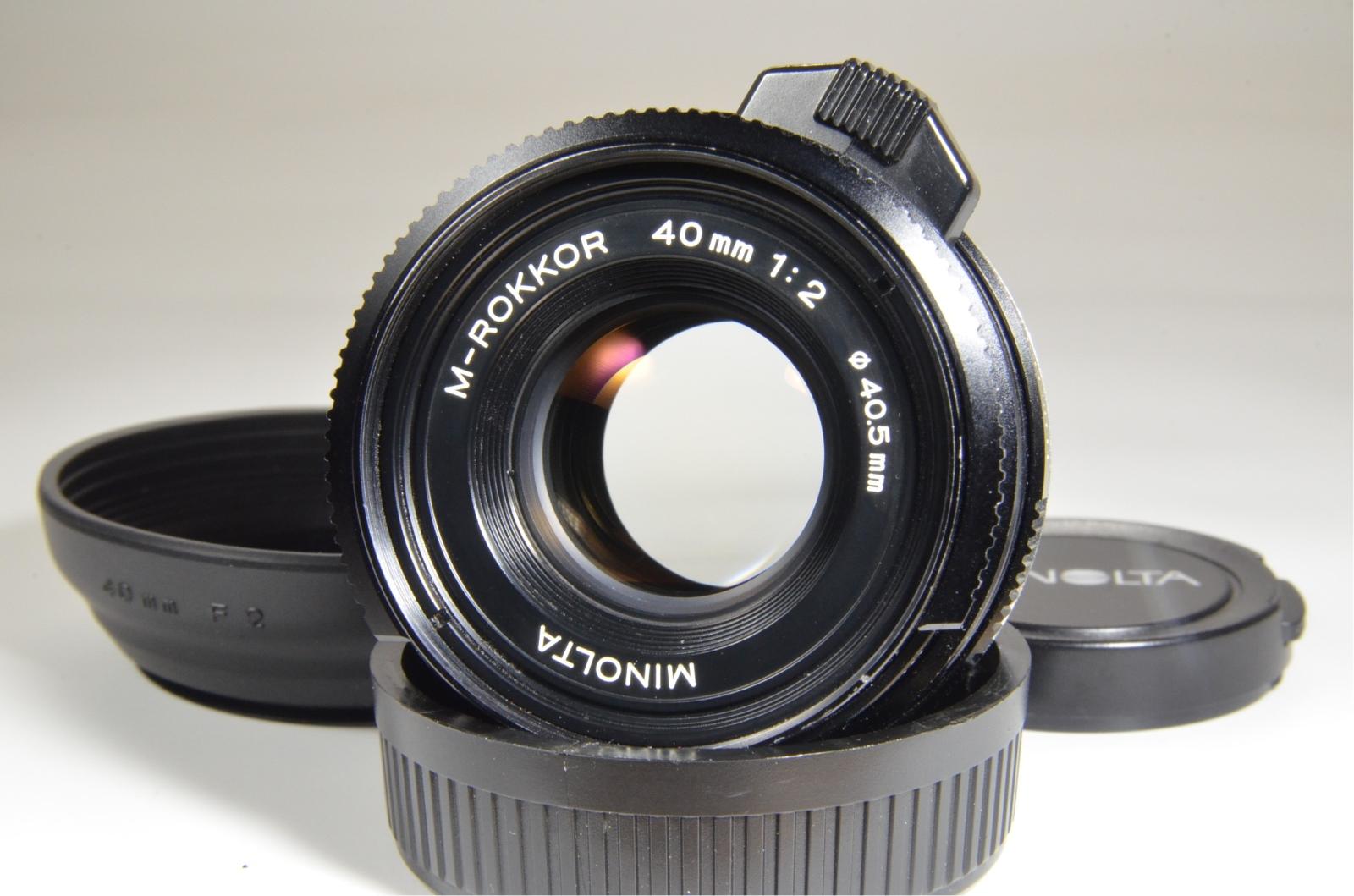 minolta cle 35mm film camera with m-rokkor 40mm f2, 28mm f2.8, 90mm f4 and flash