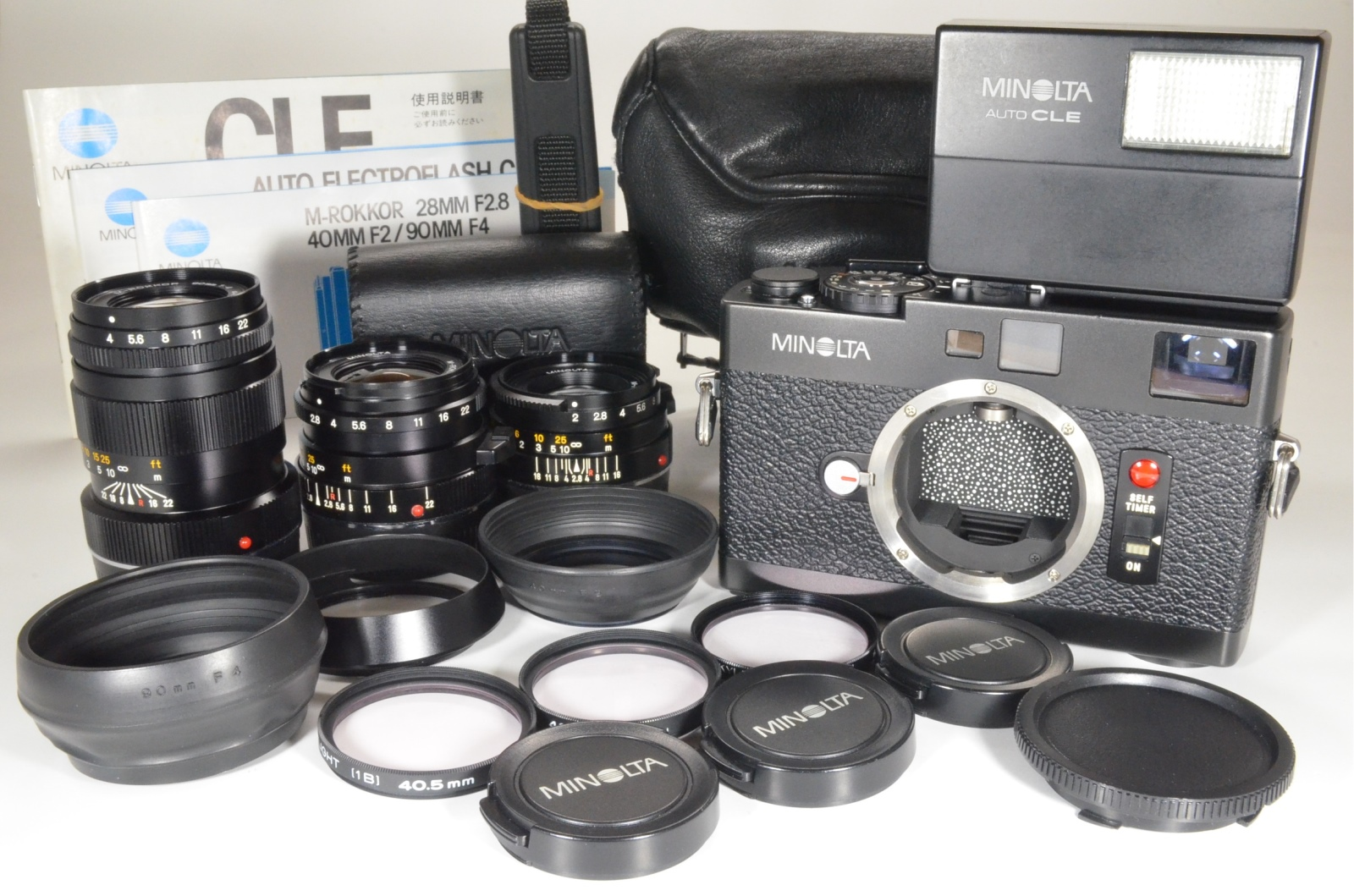 minolta cle film camera with lens m-rokkor 40mm f2, 28mm f2.8, 90mm f4 and flash