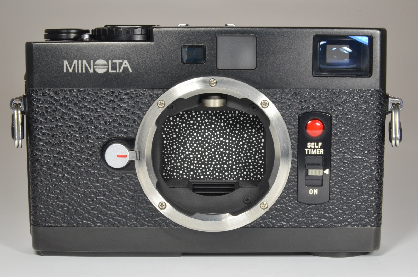 minolta cle 35mm film camera with lens m-rokkor 40mm f2, 90mm f4 and 28mm f2.8